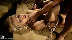 Hot BDSM action with blondie bound and banged in the dungeon
