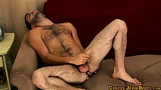 He has to lay back stroking his cock and fingering his hairy ass