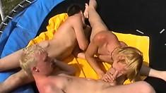 Two jocks pound their brunette friend's boycunt on a trampoline