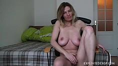 Voluptuous blonde milf Vanessa displays her big boobs and fingers her shaved peach