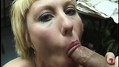 Short-haired blonde slut in high heels gives a sloppy POV blowjob
