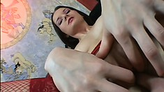 Busty young girl in sexy red lingerie pleases her holes with her fingers and a dildo
