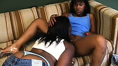 Two sexy black girls satisfy each other's lesbian desires with a strap-on dildo