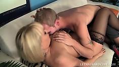 Stunning blonde cougar keeps her hot stockings on while banging