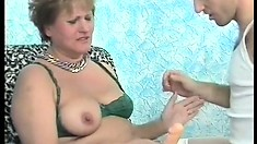 Mature grandma in stockings gets some love from a younger cock