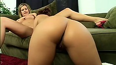 Lusty young lesbian enjoys drilling her friend's slit with a dildo