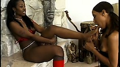 Black lezbos with a foot fetish still do the standard pussy eating and toying