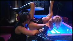 Boobilicious blonde stripper, Trina Michaels, rides his pole