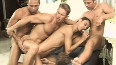 Five lustful guys get together in the living room for a gay orgy