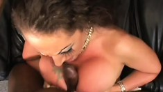 Busty brunette milf has a hung black guy fucking her pussy on the sofa