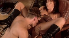 Busty redhead gets her lovely pussy licked, fingered and fucked in the library