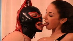 Masked lesbo is licking the hard pink nipples of amusing ass peddler