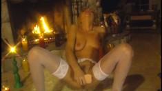 Ravishing blonde in white stockings Mila masturbates with a huge dildo