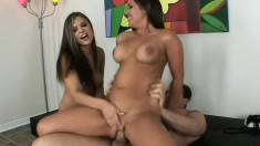 A pair of brunette pretties pounce on his pecker in a three way