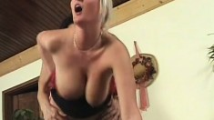 Buxom blonde lady blows and rides a young stud's big cock on the couch