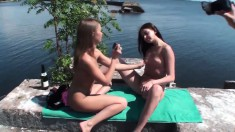 Three marvelous young babes engage in hot lesbian sex in the outdoors