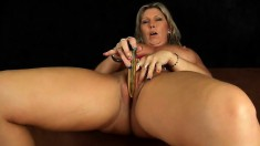 Big breasted mature Gitte uses a dildo to satisfy her sexual desires