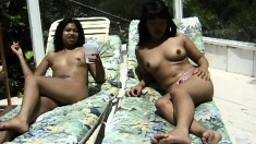 Two horny sluts sunbathe while they play with their fine bodies