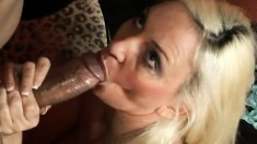 Blonde MILF wraps her lips around his black dick and sucks him off