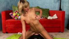 Petite blonde beauty rides the sybian and enjoys outstanding pleasure