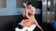 Ripped hunk is treated to a massage and an anal fuck in the gym