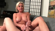 Busty blonde housewife Payton Hall offers her husband a great handjob