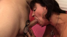 Stacked redhead cougar has a long dick providing outstanding pleasure