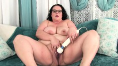 Chunky brunette with glasses uses her favorite toys to find pleasure