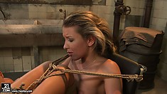 Mistress Kathia ties her legs up high and sticks in a dildo to fuck her