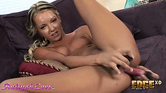 Sexy slender blonde with perky tits drills her holes at the same time with sex toys