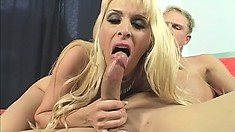Holly savors the taste of her peach all over his shaft and reveals her footjob skills