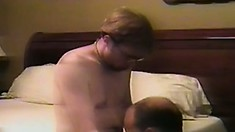 On the bed, two gay lovers exchange oral pleasures and satisfy their desires