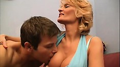 Buxom blonde cougar Aniko has a young stud drilling her needy snatch