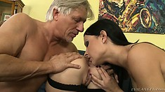 Older dude gets two young bimbos to pleasure him with their feet