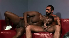 Black hunk lifts his legs up to get his tight cumhole reamed