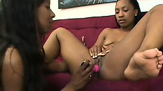 Two attractive black lesbians making each other cum hard on the couch
