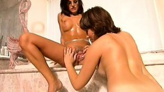 A little tub action for two loving lesbians poking and licking pussy