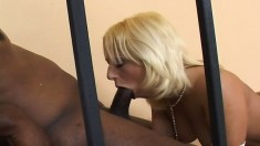 Big breasted blonde with a sublime ass fucks a black rod on the stairs
