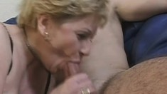 Horny mature blonde lies on the couch and a young stud fucks her pussy