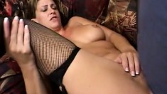 Brunette bimbo in a garter belt and stockings swallows big loads