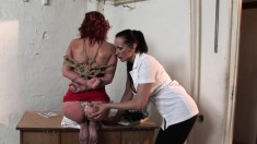 Nasty redheaded babe takes in a fat dildo in this hot lesbian action