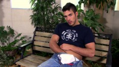 Muscled hottie Niko Delong slips out of his blue jeans to stroke his stiff prick