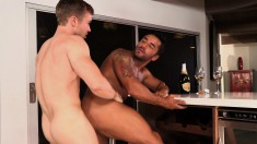 Skinny young dude has his bulging prick worked by a muscled hunk