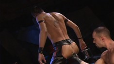 Provoking guy in leather boots engages in some intense fisting action