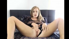 horny blonde fingering her pussy
